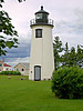 In 1855 a new smaller tower known as the 'Bug Light' was added to the lighting system on Plum Island.  In August the following year one of the original towers was destroyed when it was struck by lightning and burned.  Rather than replace the destroyed tower the Bug Light was used as the front range light.