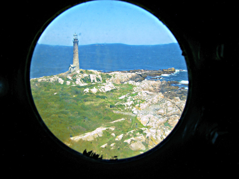 **View of the North Tower from a porthole in the South Tower watch room** For two nights Maria Bray tended the lights of both towers through the blizzard in heavy snow to provide assistance to any ships at sea.  Alexander was finally able to return to Thacher Island on Christmas Eve and celebrate a very thankful holiday.