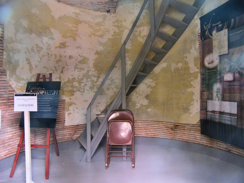 **A view inside one of the towers**<br /> Erosion of the bluff continued (notice a theme here?) and by 1911 the north tower was just 8 feet from the edge of the cliff.  The Lighthouse Service decided the time had come to make Nauset a single light station and the center tower was moved and attached to the 1876 Keepers House.  In June 1911 the light was given a new characteristic of 3 flashes every 10 seconds as a tribute to the Three Sisters Lights.