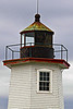 In 1856 the lantern's oil lamps and reflectors were replaced with a 4th Order Fresnel lens. Over time the weight of the lantern and tower caused damage to the roof of the dwelling. A fire in the dwelling in 1878 caused further damage but repairs were made that allowed the lighthouse to serve until 1890.
