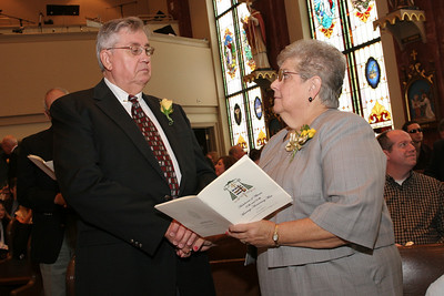 Tony and Nancy Kanicki of St. Catherine of Siena Church, Kennesaw, renew their wedding vows. The couple married on July 16, 1960 at St. Hyacinth Church, Bay City, Mich.