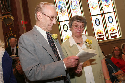 An emotional Joan Sawicki of Holy Family Church, Marietta, stands beside her husband Richard as he renews his vows. The couple will be married 60 years on the twenty-first of this month.