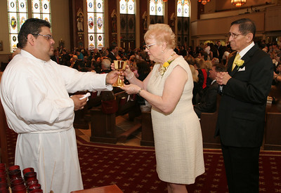 Billie Eyzaguirre, center, and her husband of 50 years, William prepare to receive the blood of Christ during holy Communion. The couple attends Prince of Peace Church, Flowery Branch.