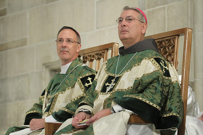 Bishop-designate Gregory Hartmayer, right, sits on the altar with Bishop Luis Zarama, Auxiliary Bishop of Atlanta, during a Sept. 1 Mass of thanksgiving marking Hartmayer's sendoff from the Archdiocese of Atlanta to the Diocese of Savannah.