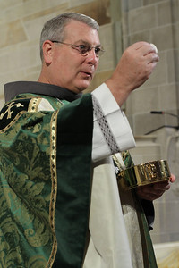 Bishop-designate Gregory Hartmayer distributes holy Communion during the Mass. Hartmayer will be installed as the 14th Bishop of the Savannah Diocese during his Episcopal Ordination on Oct. 18.