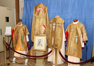 Following the anniversary Mass and on display outside the gymnasium were the historic vestments worn Nov. 8, 1956 during the installation of Atlanta's first Catholic bishop, Francis E. Hyland. The gymnasium is in a building named after the late bishop.