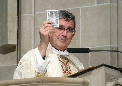 """I never get into a pulpit without her beside me. With her on one side and St. Theresa on the other side, I am invincible,"" said homilist Father Richard Lopez, as he held up a memorial prayer card of Grey Nun of the Sacred Heart Sister Rita Raffaele. She worked for 34 years in the Archdiocese of Atlanta before here death in 2004.  (Page 14, September 16, 2010 issue)"