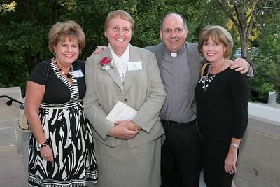 Grey Nun of the Sacred Heart Sister Dawn Gear, second from left, poses with (l-r) Collette Sherry and her siblings Father Michael Kingery, pastor of Holy Trinity Church, Peachtree City, and Karen McConnell. Their other brother, Father Patrick Kingery, was educated for 12 years by the Grey Nuns.       (Page 14, September 16, 2010 issue)