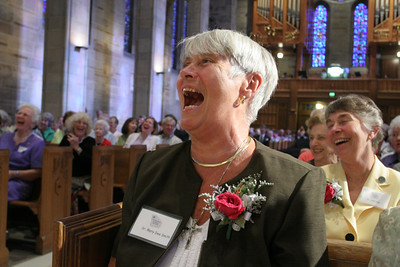 Grey Nun of the Sacred Heart Sister Mary Dee Smith, foreground, was not the only person in the congregation who found humor in Father Richard Lopez's homily. Sister Mary Dee taught seventh and eighth grade math at Christ the King School 1970-71.