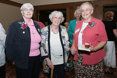 Betty Ramsdell, center, brought a photo of St. Marguerite D'Youville, Grey Nuns of the Sacred Heart foundress, to share with the sisters. The photo has been in her family for some 100 years. Here she stands between Sister John Helen Main, left, and Sister Mary Lee Farrell.
