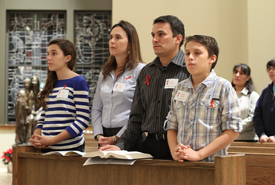 (L-r) Fourteen-year-old Sophia Villegas, her mother Juliana, her father Jose and her 11-year-old brother Felipe are on hand for the World AIDS Day Mass at Immaculate Heart of Mary Church, Atlanta. The family serves in the parish AIDS ministry.  (Page 20, December 6, 2012 issue)