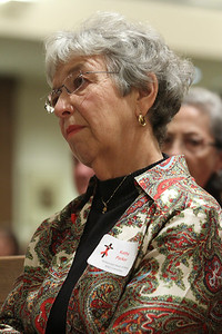 Kathy Parker listens to Archbishop Gregory's message during the World AID Day Mass. Parker has headed up the AIDS ministry at Immaculate Heart of Mary Church, Atlanta, for 12 years.