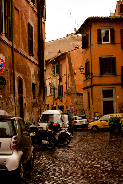 Parked Cars through out the Block in Rome Italy