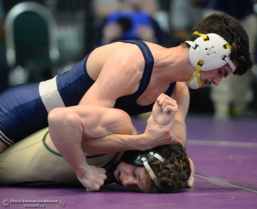 Pleasant Valley's Jake Mora battles Chester's Callum Kremer during the Northern Section Master's Wresting Tournament in Redding on Friday, February 15. (Matt Bates -- Enterprise-Record)