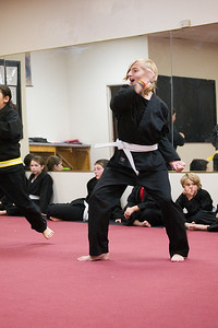 Hannah testing for her low-yellow belt