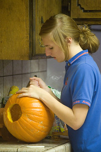 Hannah carving her pumpkin....the day after.