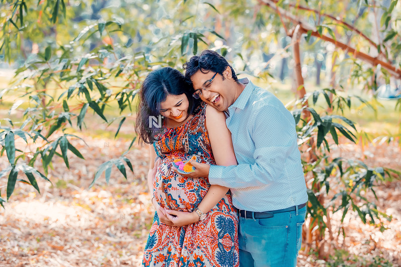 Joyous new parents during their maternity photoshoot session in Bangalore