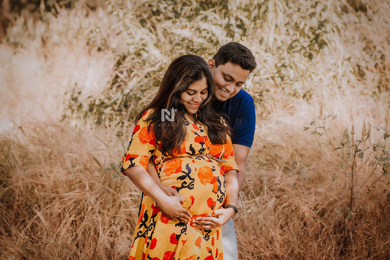 Happy new parents during a maternity photoshoot