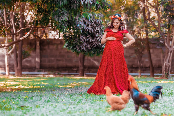 Gorgeous mom-to-be in her red gown during a pregnancy photography session