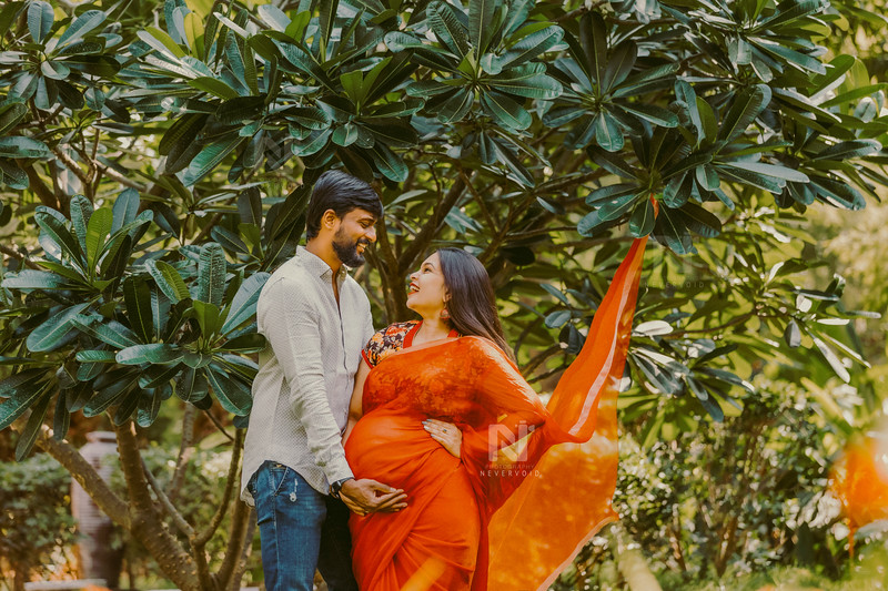 Mom-to-be in a lovely saree along with her husband during a maternity photoshoot
