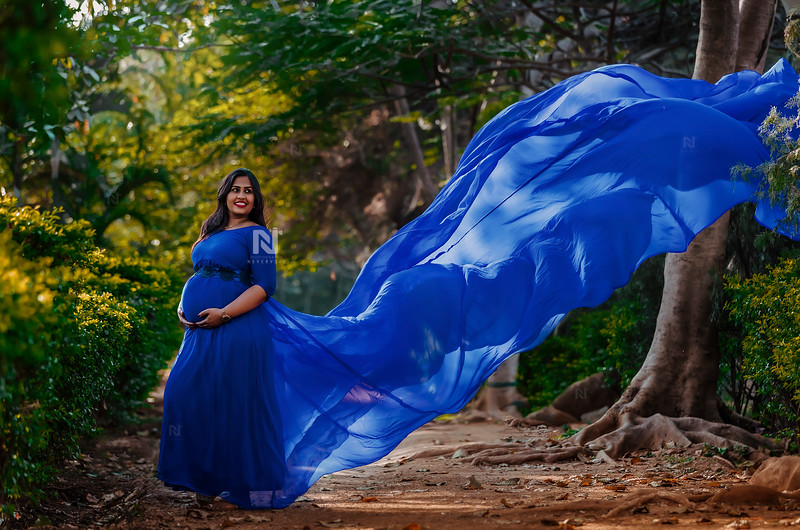 Gorgeous mom-to-be in her blue flying gown