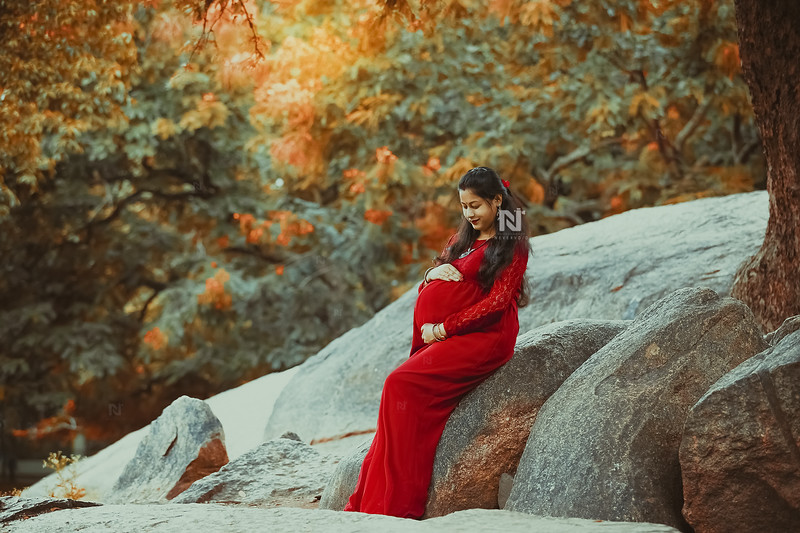 Mom-to-be in her beautiful red gown in the gardens of Bangalore