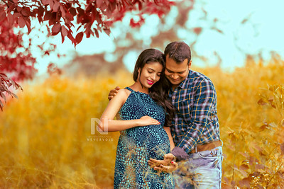 Maternity photoshoot for a happy young couple