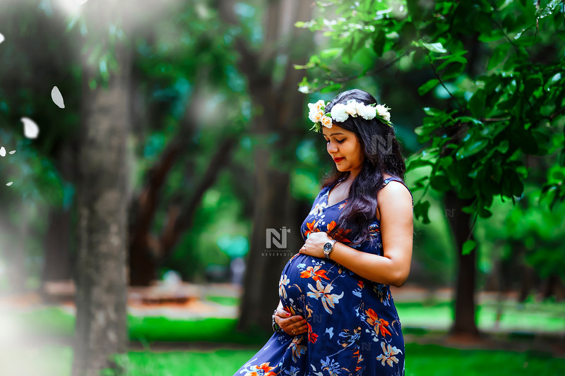 Mom-to-be in her blue maternity gown in Lal Bagh gardens during her photoshoot