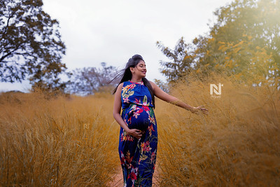 Gorgeous mom-to-be walking in the gardens of Bangalore