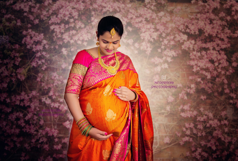 A gorgeous Indian lady with a cute baby-bump.