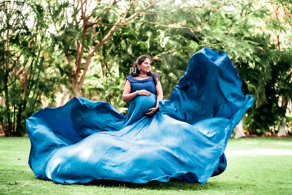 Stunning mom-to-be in her long trail flying maternity gown