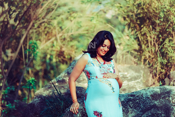 Gorgeous mom-to-be in a beautiful dress during her Maternity photoshoot
