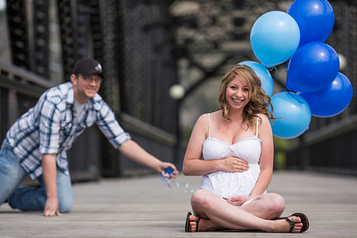 Ryan holding balloons as Libby poses for some maternity portraits in Milltown, MT