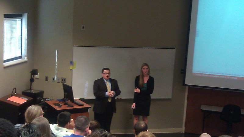 Patrick Bonham and Angela Zanotti presenting their talk based on the research they did with Dr. Zoller last summer during the SNU Summer Research Experience.