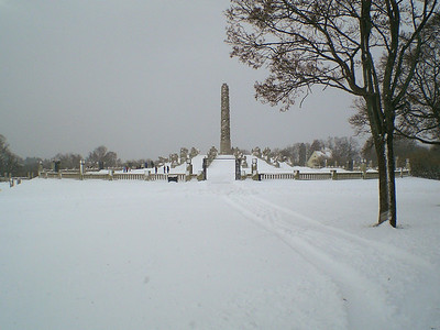 "Gustav Vigeland's Sculpture Park in Oslo. A long shot of the ""Monolith"" and other sculptures on the Monolith Plateau."