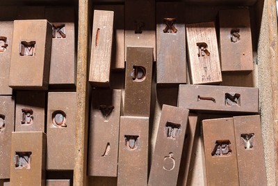 Copper matrices of the 24-point uppercase Tallone type, stamped with the punches engraved by Charles Malin. They were stamped by the Radiguer Foundry, which also cast the type.