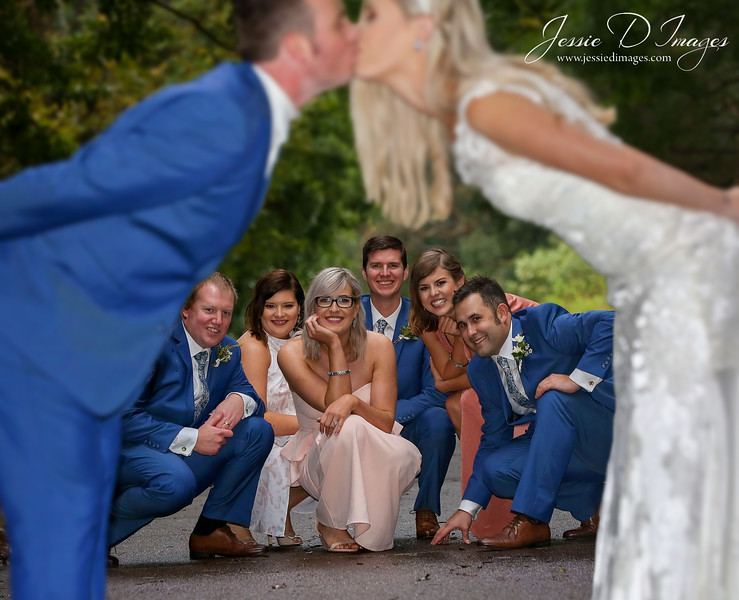 Bride and groom kiss - bridal party photo - wedding fun