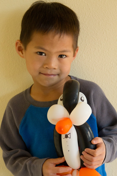 Matthew showing off his penguin