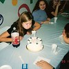 Blowing out candles at my 12th birthday party.