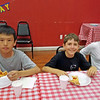 Matthew and his friends eating pizza.