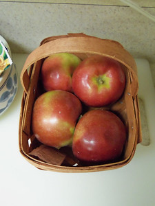 tiny basket of apples