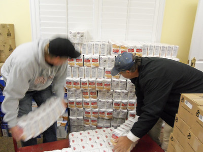 Stacking pallets full of cornmeal mix donated in Oct. 2012.