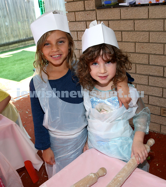 Matzah Bakery at Hug A Bub. Awen Hiroti (left) & Arya Cohen. Pic Noel Kessel.