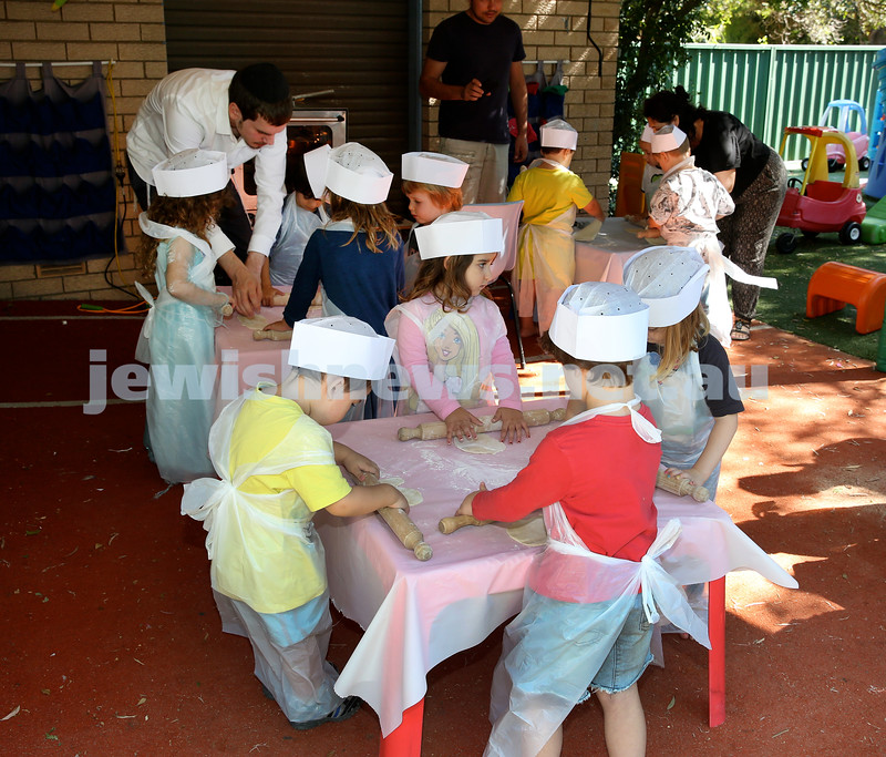 Matzah Bakery at Hug A Bub. Children baking matzah. Pic Noel Kessel.