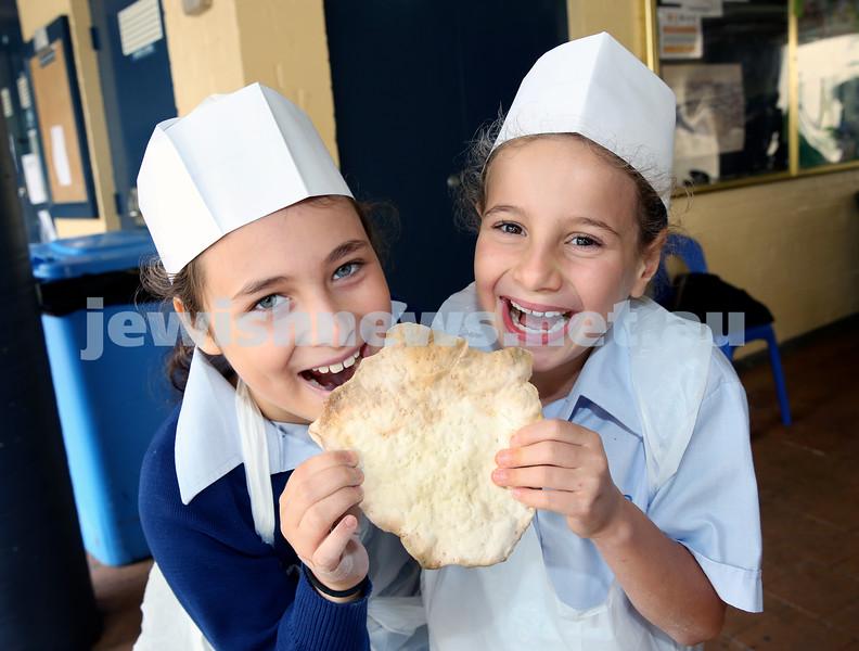 Matzah Bakery at Masada Primary School. Erin Kruger (left), Ariella Cohen. Pic Noel Kessel