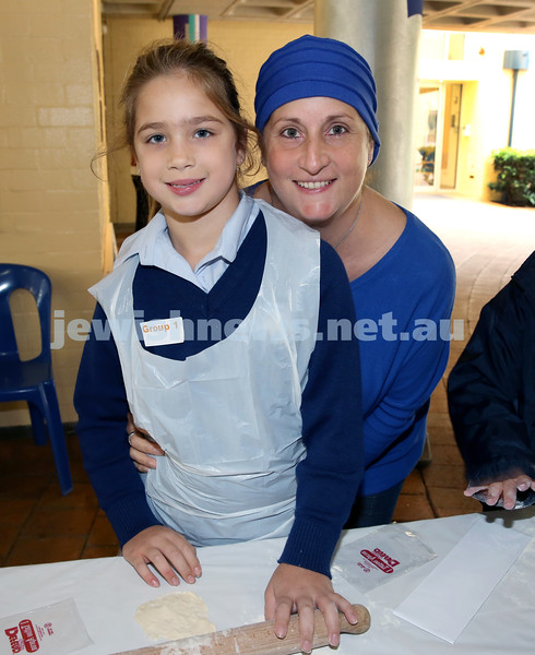 Matzah Bakery at Masada Primary School. Shyli Lewin with her mum Talya. Pic Noel Kessel