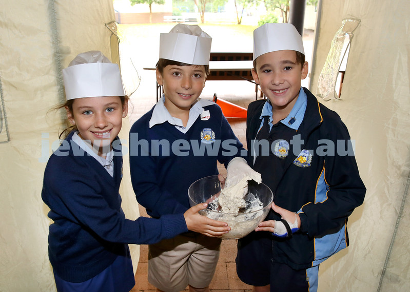 Matzah Bakery at Masada Primary School. From left: Sadie Malkin, Kai Tofner, Ryan Levy. Pic Noel Kessel