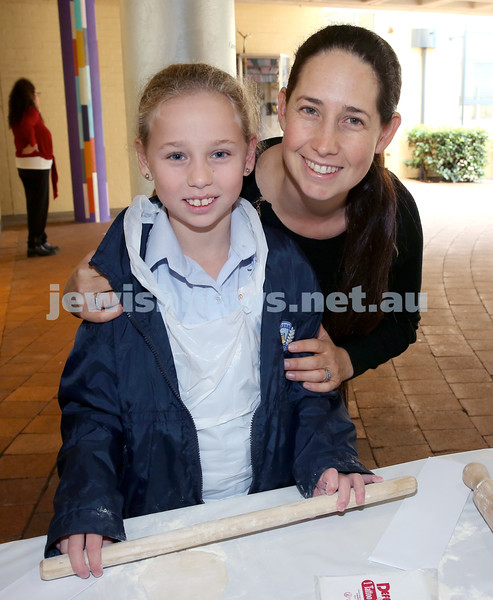 Matzah Bakery at Masada Primary School. Revi Guth with her mum Eli. Pic Noel Kessel