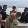 Kira signing as wedding witness