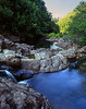 "<p></p><div id=""centered_description"">Mountain Stream, Hana Highway</div>"